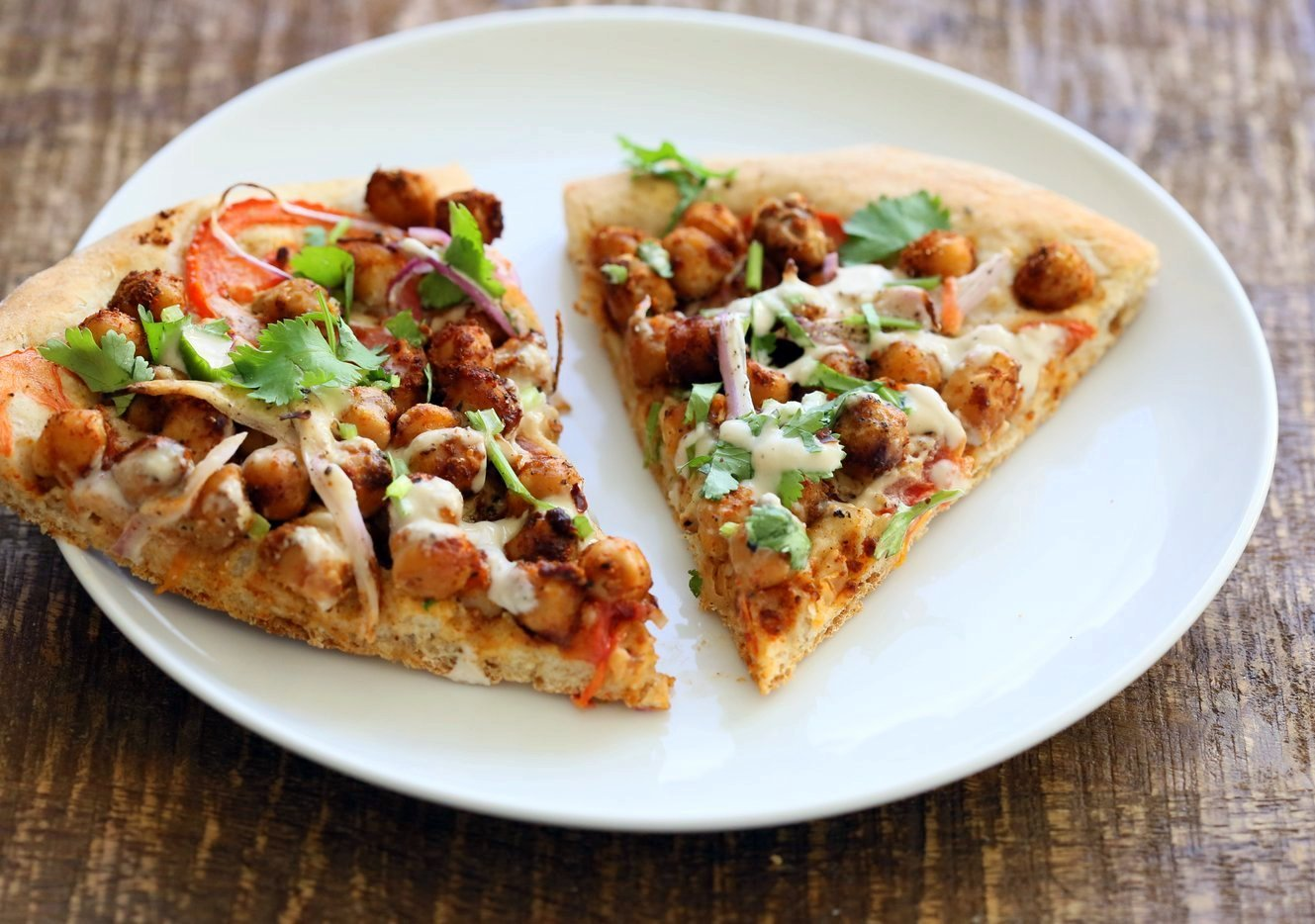 Ethiopian Berbere Chickpea Pizza with Tahini Garlic Dressing. Amazingly flavorful pizza. Dress with tahini dressing, vegan ranch or other creamy dressing. Vegan Soyfree Nut-free Recipe. Gluten-free Crust option.   VeganRicha.com