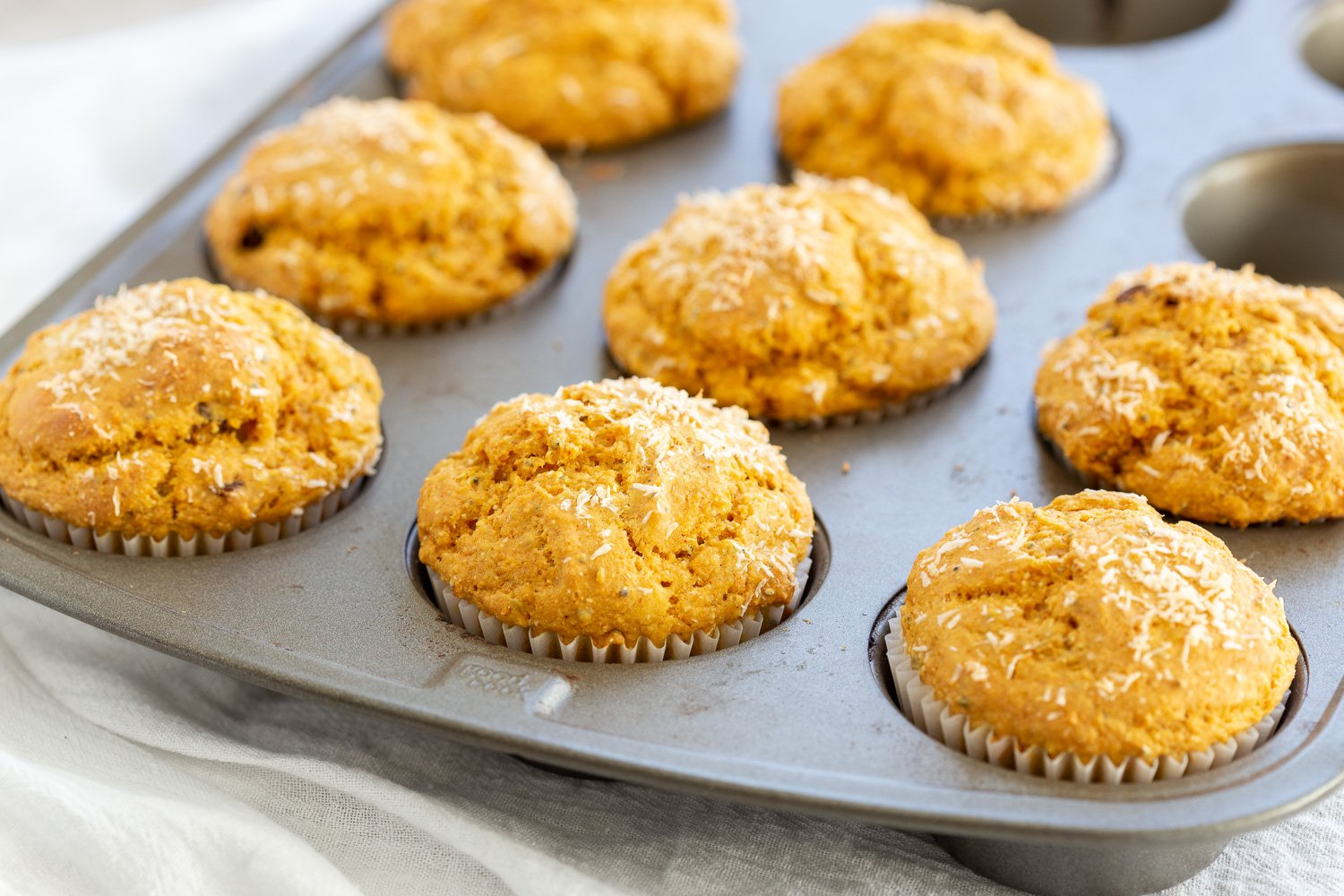 Our Vegan Turmeric Carrot Muffins in a muffin pan