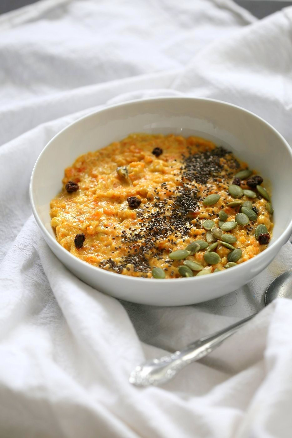 Carrot Pudding with Cardamom - Carrot Kheer Recipe. Shredded Carrots slow cooked with almond milk, roasted nuts and cardamom. Serve as is or top with toasted nuts, seeds and chia. Vegan Gluten-free Soy-free Nut-free option | VeganRicha.com