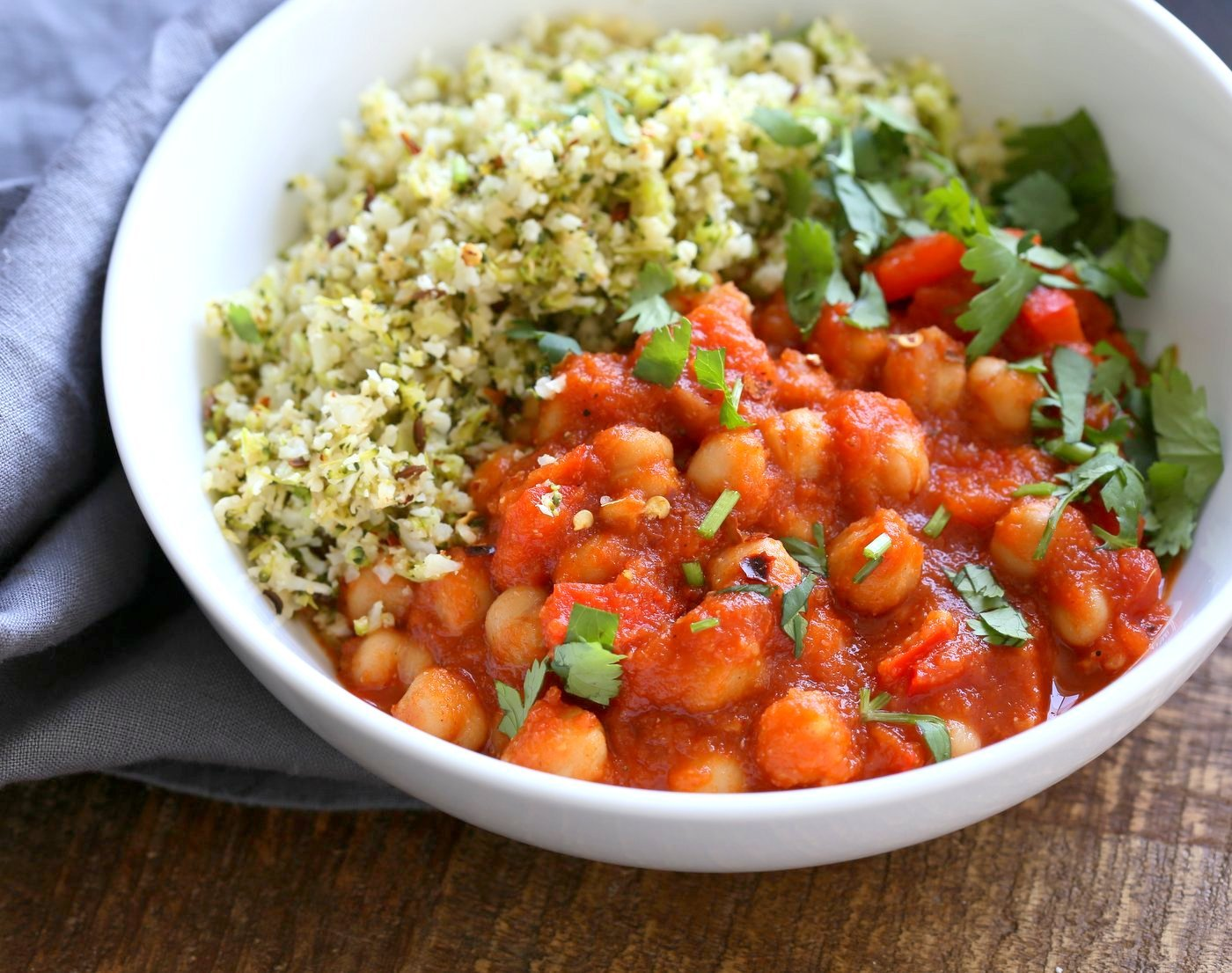 Flavorful Spanish Chickpea Stew with Cumin scented Cauliflower Broccoli Rice. Smoky tomatoey Chickpea Stew can be served over rice or grains or cauliflower or broccoli rice. Vegan Gluten-free Nut-free Grain-free Soy-free Recipe | VeganRicha.com