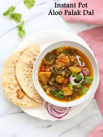 Instant Pot Aloo Palak Dal. Spiced Potato Spinach Lentils made in a pressure cooker or Instant Pot. Saucepan option. Vegan Gluten-free Soy-free Nut-free Recipe | VeganRicha.com