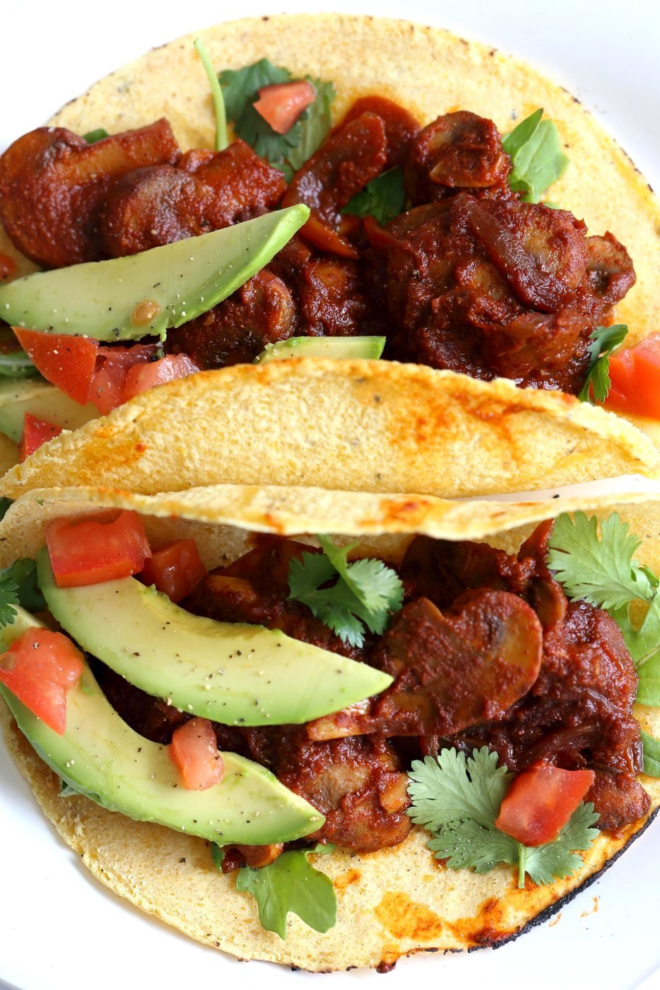Vegan Barbacoa Mushroom Tacos . These saucy Barbacoa Tacos are super easy and versatile. Use the from scratch chile sauce with beans, lentils or other shredded vegetables for variation. #Vegan Barbacoa Recipe. #Glutenfree #Nutfree #soyfree #Recipe #veganricha | Vegan Richa