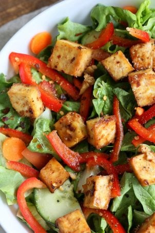 Crunchy Asian Salad With Baked Tofu & Garlic Soy Maple Dressing. Marinated and Baked Tofu over Crunchy Greens, peppers and carrots. Vegan Gluten-free Recipe | VeganRicha.com