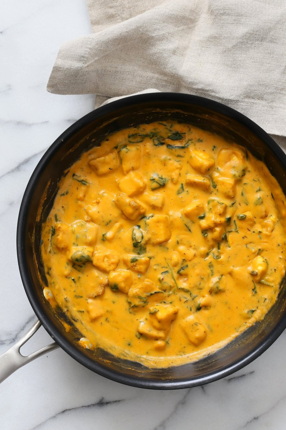 Methi Malai Paneer made vegan with Tofu and cashews. Easy Weeknight Restaurant style Indian main. Serve over Naan or rice. Vegan Gluten-free Recipe. Soy-free option | VeganRicha.com