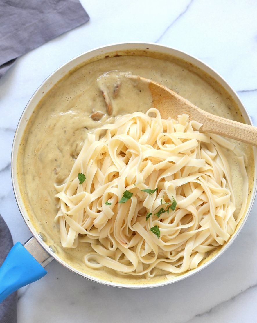 The Best Vegan Mushroom Garlic Alfredo with no nuts. Garlicky, Creamy, Amazing Vegan Fettuccine Alfredo. Nut-free, Easily Gluten-free, soy-free.   VeganRicha.com