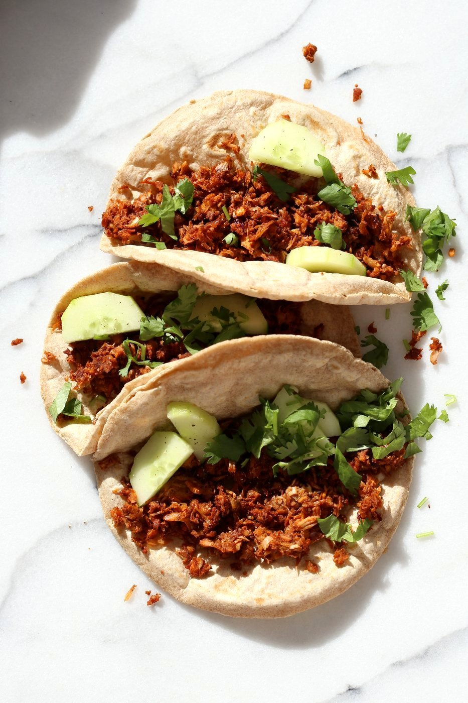 Berbere Spiced Jackfruit Tacos. Jackfruit and onion mixed with Berbere spice blend and baked to caramelized spiced perfection. Add some chickpeas to make into a hearty meal. Vegan Soy-free Nut-free Recipe, Can be Glutenfree | VeganRicha.com