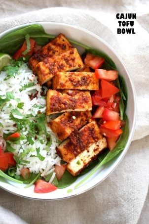 Cajun Tofu with Cilantro Lime Rice. Baked Cajun Spiced Tofu, over greens, cilantro lime rice, and tomatoes. Easy Spicy Bowl. Vegan Gluten-free Nut-free Recipe. Use Chickpea tofu to make soy-free. | VeganRicha.com