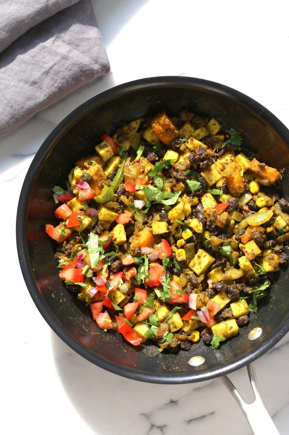 Southwestern Tofu Scramble with Chickpea Tofu. Scrambled Tofu without Soy tofu! Soy-free Breakfast Scramble with Black beans, Veggies, Sweet Potatoes, Spices, Chickpea flour Tofu. Double Protein Savory Vegan Breakfast. Gluten-free Soy-free Nut-free  | VeganRicha.com