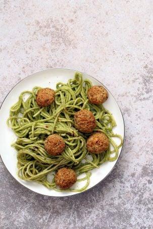"AmazingPesto Spaghetti with Vegan Meatballs made with Chickpeas. Vegetarian Chickpea Walnut ""meatballs"" over pesto pasta. Ready in 40 Minutes. Vegan Soyfree Recipe. Can be Glutenfree | VeganRicha.com"