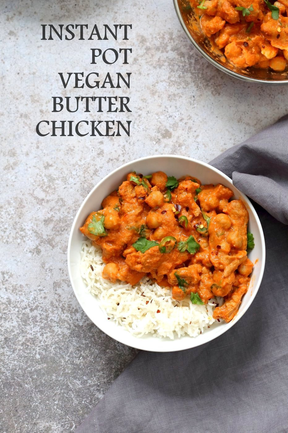 Vegan Butter Chicken in a Bowl with Rice, kept on concrete. Instant Pot Vegan Butter Soycurls and Chickpeas