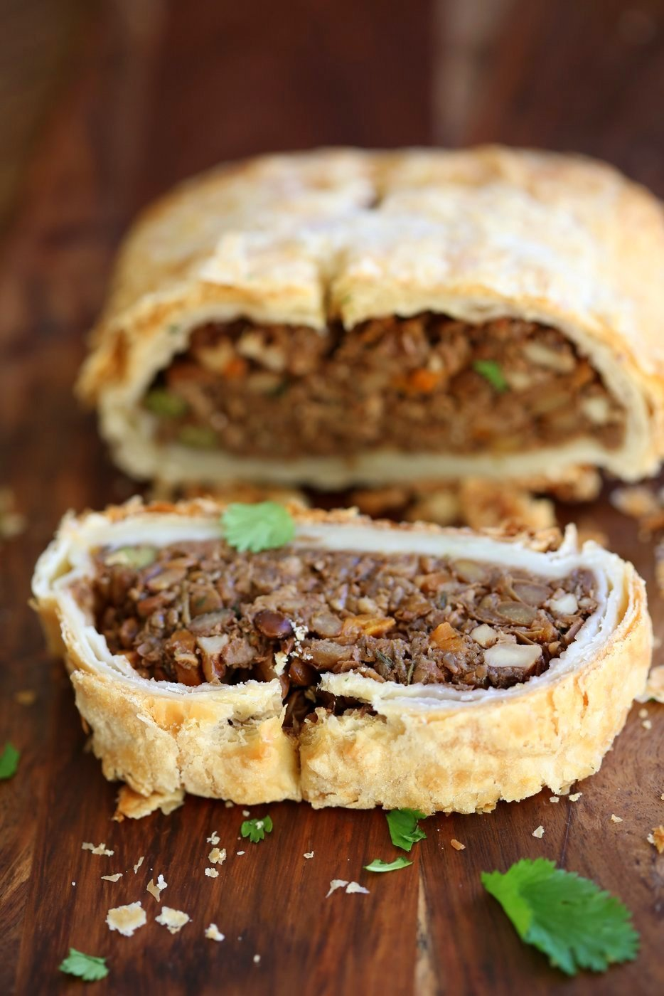 Mushroom lentil Wellington. Easy Vegan Wellington for the Holidays and potlucks. Puff pastry wrapped lentil walnut mushroom loaf.  Vegan Recipe. Make into a loaf to make gluten-free. #vegan #veganricha