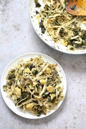 Fettuccine with Caramelized Onions, Greens and Vegan Feta - ish cheese. Easy Weeknight meal. Make the cheese ahead, then the dish is 1 Pot and 30 minutes. #Vegan, can be Gluten-free, Soy-free #veganricha   VeganRicha.com