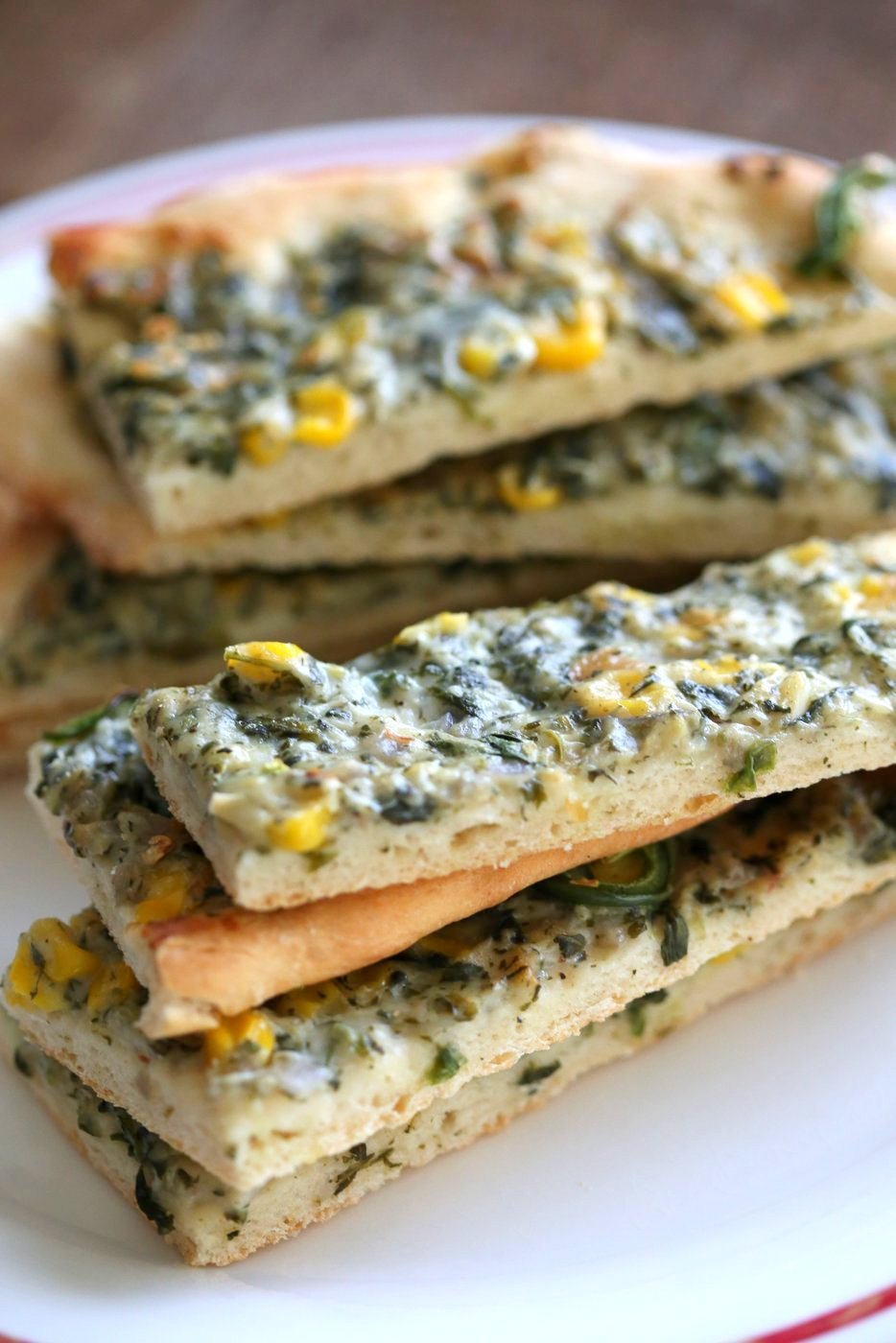 Vegan Spinach Dip Breadsticks. Creamy Corn and Spinach dip spread over pizza crust or puff pastry, bake, slice and serve. Easy Vegan Recipe. Can be gluten-free if served as a dip #vegan #veganricha #recipe #spinachdip | VeganRicha.com
