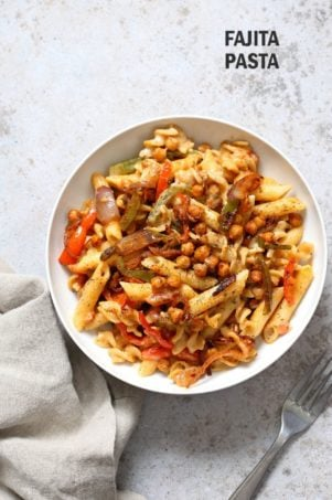 Vegan Fajita Pasta with Chickpeas and veggies. Easy Weeknight pasta with Taco seasoned veggies and beans mixed with creamy pasta. Vegan Soyfree Recipe. Can be gluten-free. #vegan #veganricha