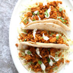 Mango BBQ Soy Curls or Jackfruit Tacos. Shredded Soy Curls or Jackfruit make a an amazing carrier for bbq sauce. Some Mango or other fruit puree takes it to the next level. Serve in sandwiches or tacos with slaw. #Vegan #Glutenfree #Recipe #veganricha | VeganRicha.com