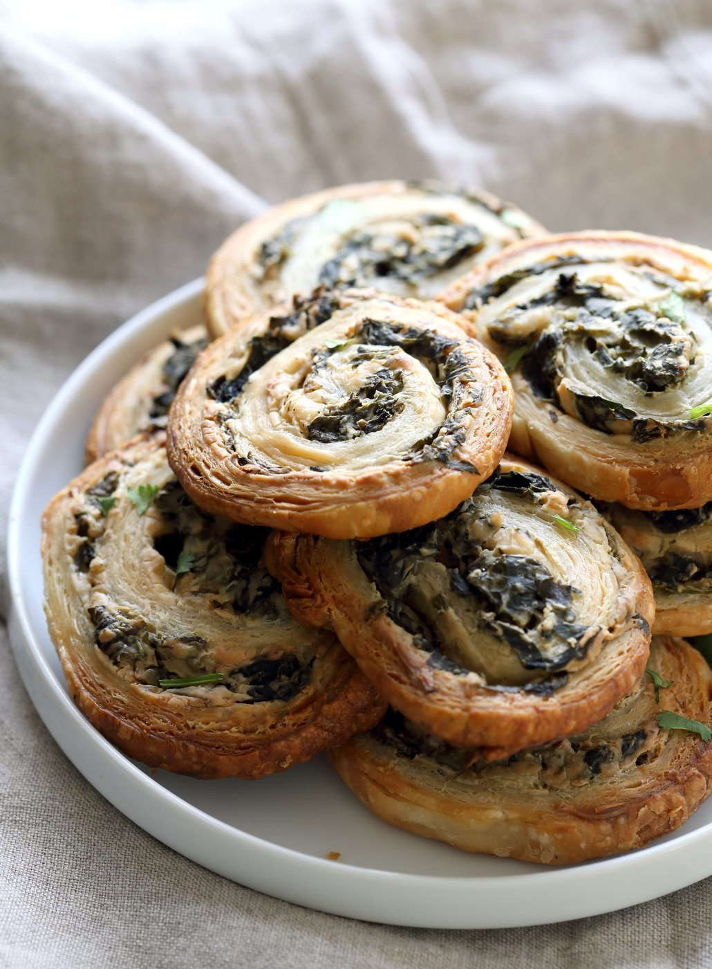 Vegan Spinach Pinwheels. Creamy cheesy Spinach dip spread on puff pastry, rolled, sliced and baked to make a great Snack. #Vegan #Soyfree #Recipe #veganricha | VeganRicha.com