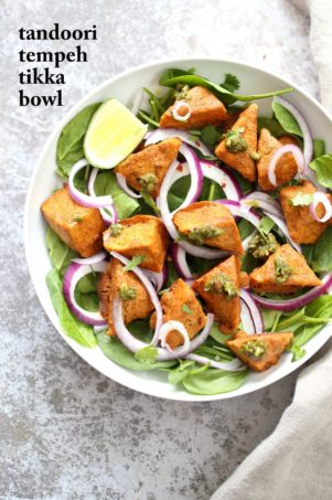 Tempeh Tandoori Tikka Bowl with Cilantro Mint Chutney. Tempeh marinated in Delicious and Flavorful Tandoori Marinade, then baked and served over greens, onions. #veganricha #Vegan #Glutenfree #Recipe. Use vegan meat subs for #soyfree | VeganRicha.com