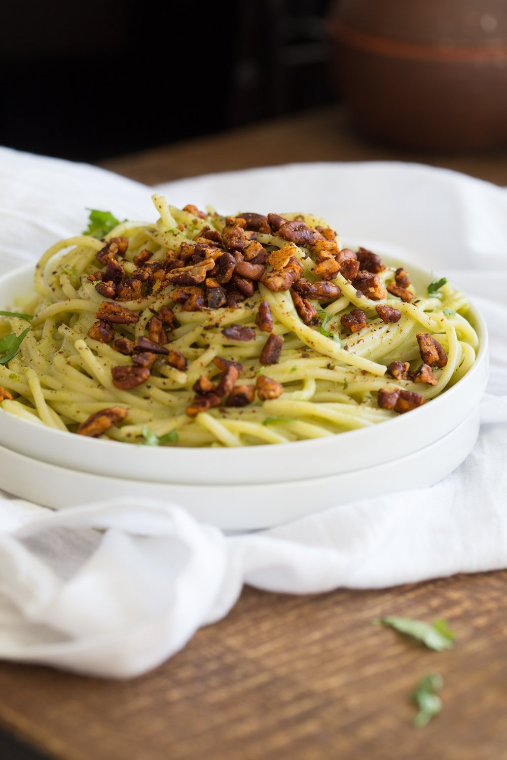 Avocado Pasta with Smoky Pecans served on a white plate