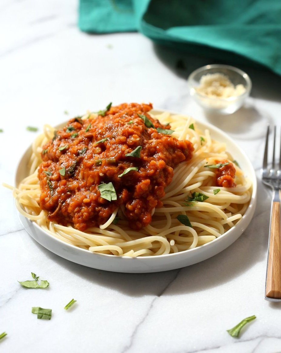 This Lentil Bolognese Sauce is hearty with Red lentils and Mushrooms and great with Spaghetti or other pasta. #Vegan #Soyfree #Nutfree #Recipe #VeganRicha. Can be gluten-free with #glutenfree #pasta | VeganRicha.com
