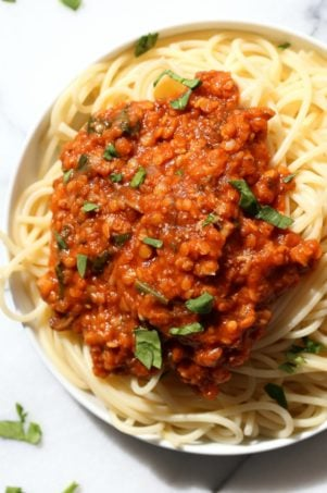 This Lentil Bolognese Sauce is hearty with Red lentils and Mushrooms and great with Spaghetti or other pasta. #Vegan #Soyfree #Nutfree #Recipe #VeganRicha. Can be gluten-free with #glutenfree #pasta   VeganRicha.com