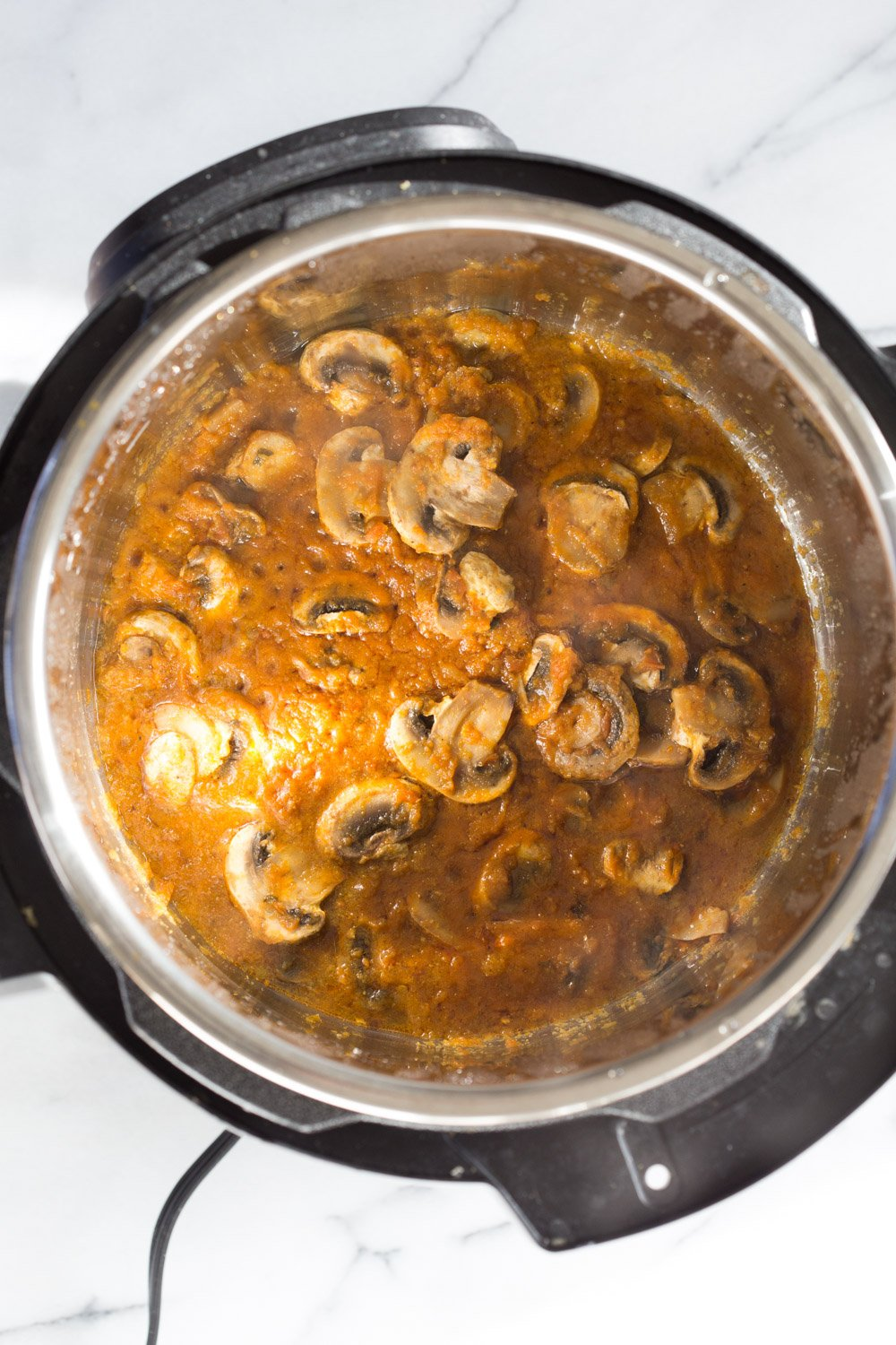Instant Pot Mushroom Masala. Easy Mushrooms and peas in Creamy Sauce made in an Instant Pot. Add chickpeas for a hearty meal. #Vegan #Gluten-free #Soyfree #Recipe. Can be #nutfree  #VeganRicha