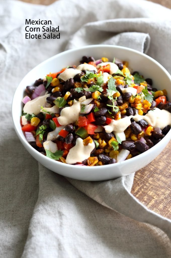 Mexican Street Corn Salad in a white bowl, placed on linen