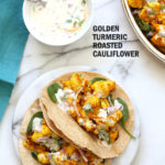 Turmeric Roasted Cauliflower with Raita Dip. These Delicious Golden Cauliflower Bites are easy and quick. Serve with a dash of lemon or with a Yogurt onion dip or Green Chutney. #Vegan #Soyfree #Nutfree #veganricha #Recipe. Can be #glutenfree