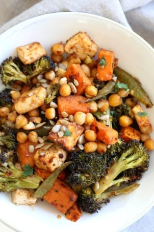 Sheet Pan Veggie Dinner with Broccoli, Sweet Potato, Tofu, Chickpeas, Sunflower seeds dressed with Miso Maple Dressing. #Vegan #Glutenfree #Nutfree #Recipe. Can be #soyfree with chickpea miso #VeganRicha