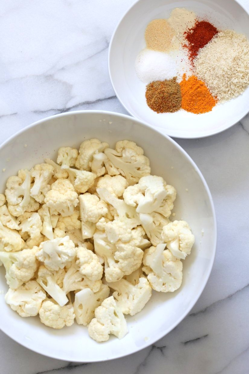 Cauliflower florets and Spices. Turmeric Roasted Cauliflower with Raita Dip. These Delicious Golden Cauliflower Bites are easy and quick. Serve with a dash of lemon or with a Yogurt onion dip or Green Chutney. #Vegan #Soyfree #Nutfree #veganricha #Recipe. Can be #glutenfree