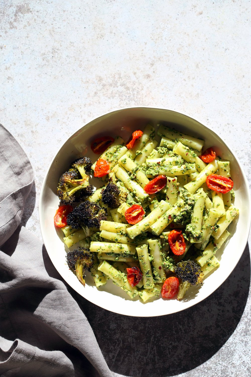 Vegan Pesto Pasta with Charred Broccoli. Easy Vegan Pesto with Ziti, served with roasted cherry tomatoes and roasted broccoli. 21 Gm of Protein #Vegan #Soyfree #Recipe #VeganRicha. Can be #glutenfree and #nutfree | VeganRicha.com