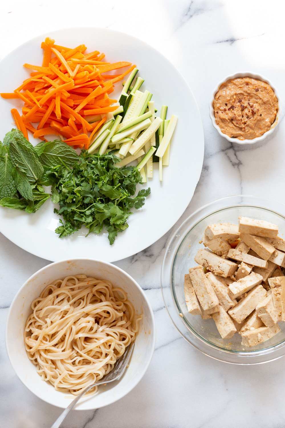 Ingredients for our vegan Fresh Spring rolls in white bowls and plates