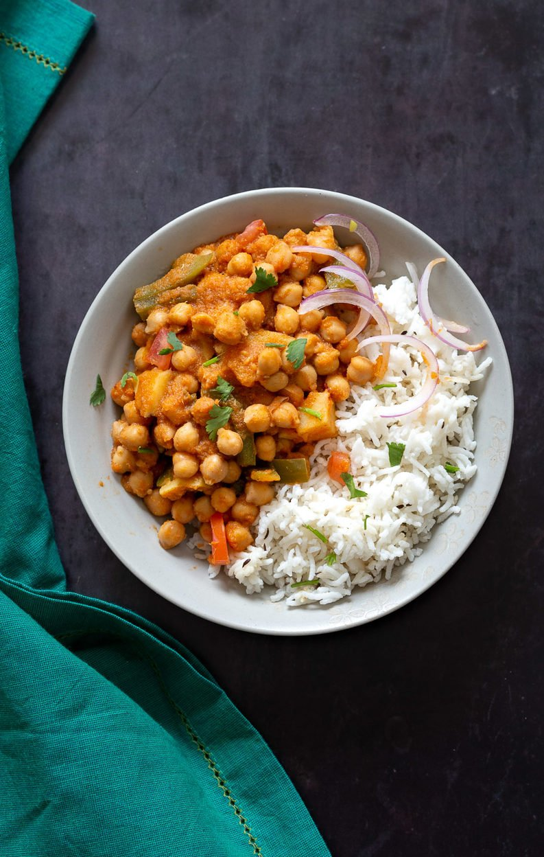 Kadai Chole is a delicious Chickpea curry generally made in wok. 1 Pot 30 min Spiced Chickpeas and Potatoes. Simple Indian sauce paired here with potatoes. #Vegan #Indian #Glutenfree #Soyfree #Nutfree #Recipe #indianvegan #VeganRicha