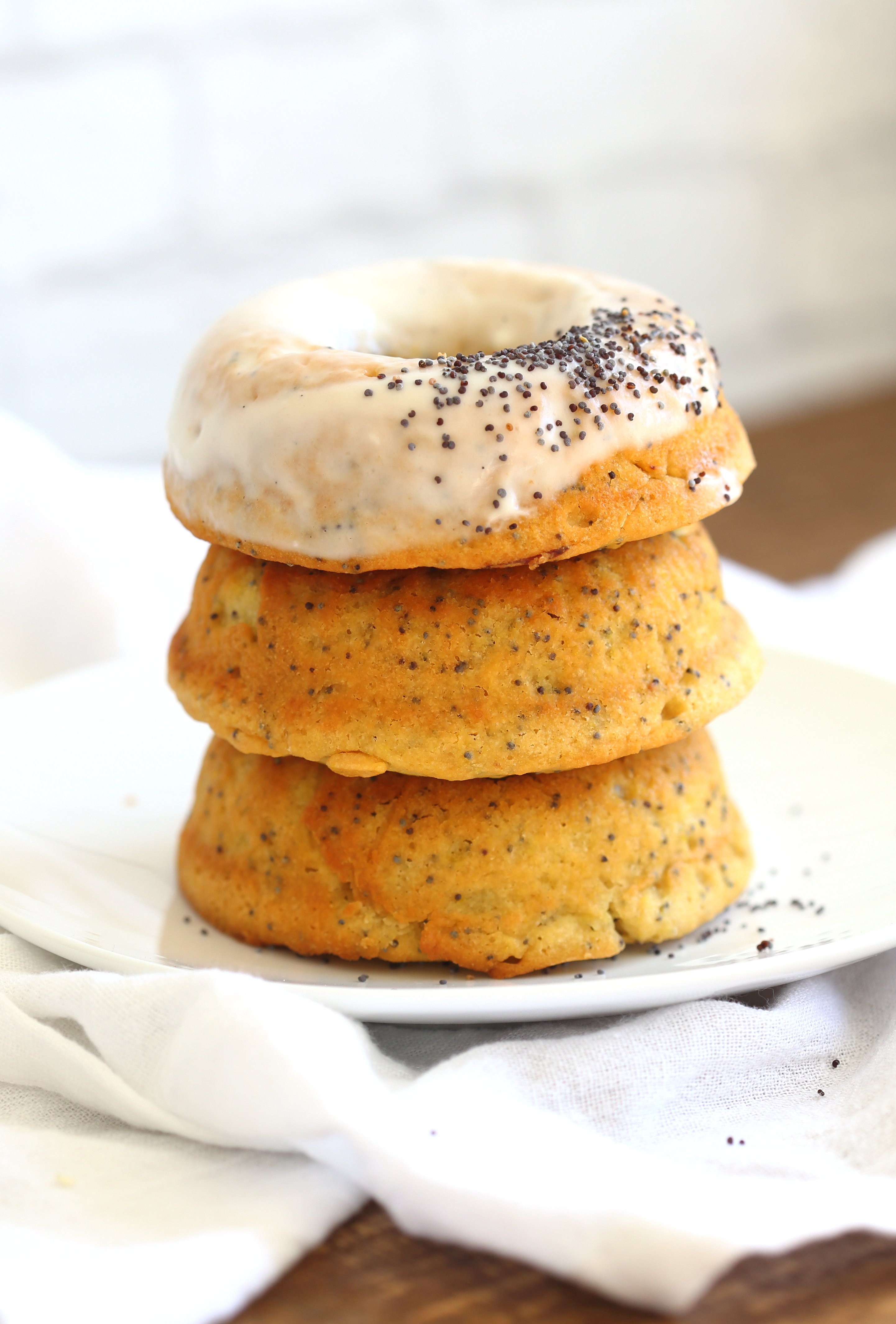 Lemon Poppy Seed Donuts - #Vegan Lemon Poppy Seed Donut Recipe. Simple to make and ready in less than 30 minutes. Top with cream cheese frosting. #VeganRicha #recipe #donuts #Nutfree #lemonpoppyseedonut