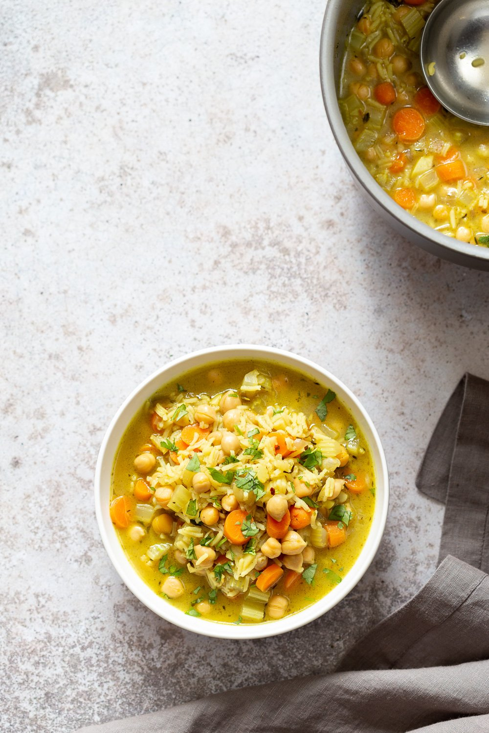 Comforting and Healing Vegan Chickpea Rice Soup with Veggies. A glutenfree variation of Vegan Chicken Noodle Soup. Easy 1 Pot 30 minute meal. #vegan #veganricha #Glutenfree #Nutfree #Recipe #Soyfreeoption