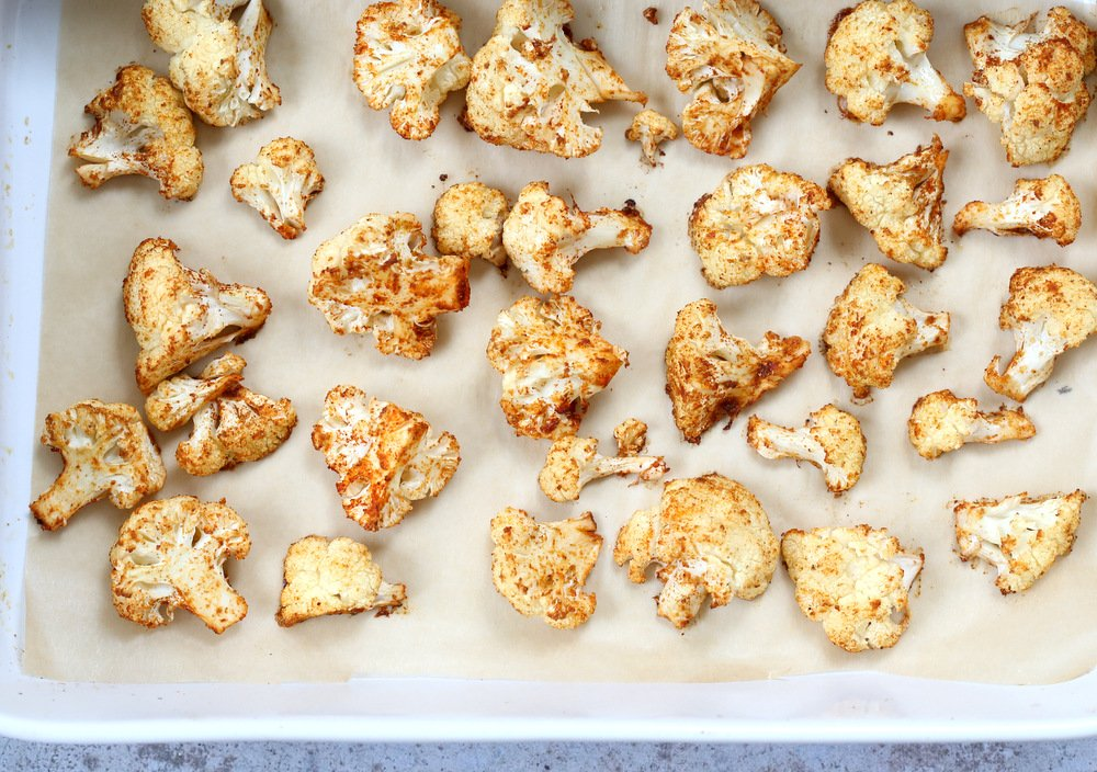 Spiced Cauliflower Florets in a white baking dish for our Vegan Cauliflower Tikka Masala