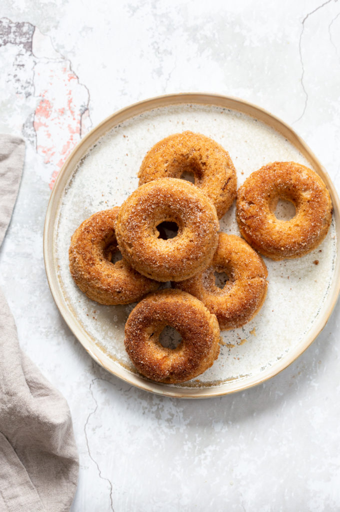 Baked Apple Cider Donuts. These Cider donuts have amazing spiced flavor with concentrated cider. Perfect for fall. #Vegan #Soyfree #Recipe.