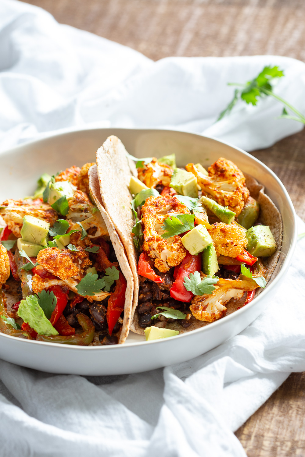Sheet Pan Fajitas. Cauliflower, Peppers, Beans tossed in Chipotle Fajita Sauce and baked. Serve in tacos or Bowl #Vegan #Glutenfree #Soyfree Nutfree #Recipe #VeganRicha