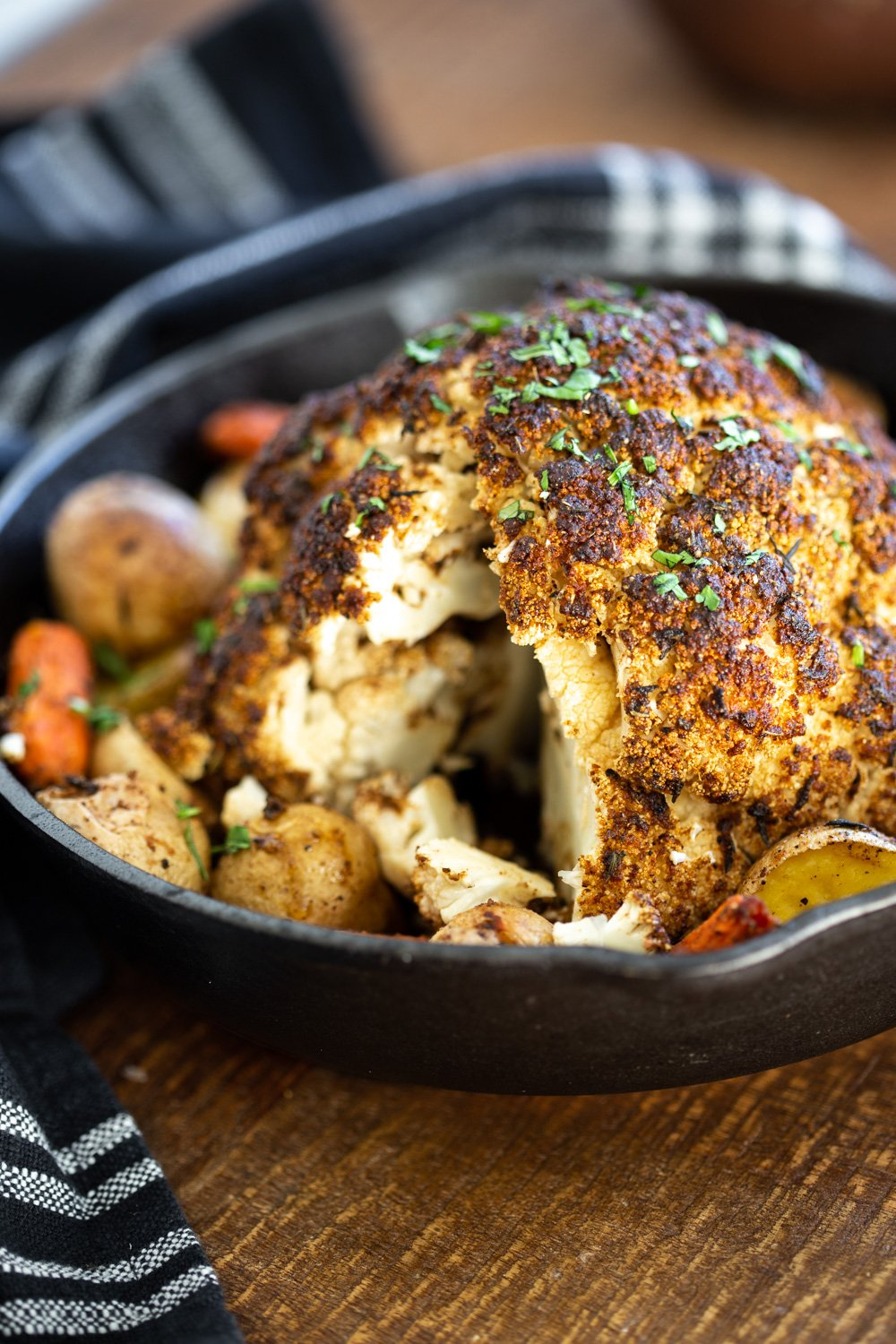 Whole Roasted Cauliflower. This Baked Whole Roasted Cauliflower is marinated in flavorful of herbs and spices and baked to perfection to make a fabulous Holiday table option. #VeganRicha #holiday #Vegan #Glutenfree #Nutfree #recipe. Can be #soyfree