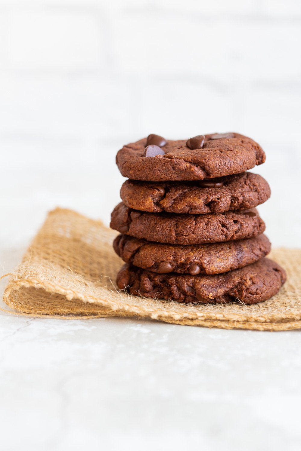 Grainfree Vegan Chocolate Tahini Cookies on parchment lined baking tray