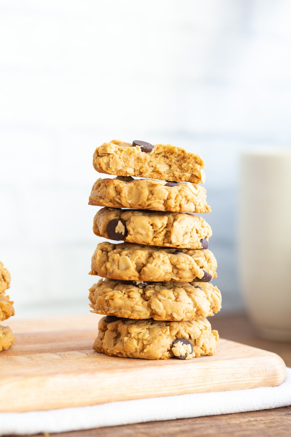 These Vegan Peanut Butter Oatmeal Chocolate Chip Cookies are melt in your mouth, delicious and hearty cookies. They need 1 Bowl, just 8 Ingredients and are ready within 30 Minutes. #Vegan #Soyfree #Recipe #Glutenfreeoption #refinedsugarfree #refinedoilfree #VeganRicha #peanutbutteroatmealchocolatechipcookie #veganpeanutbutteratmealcookie
