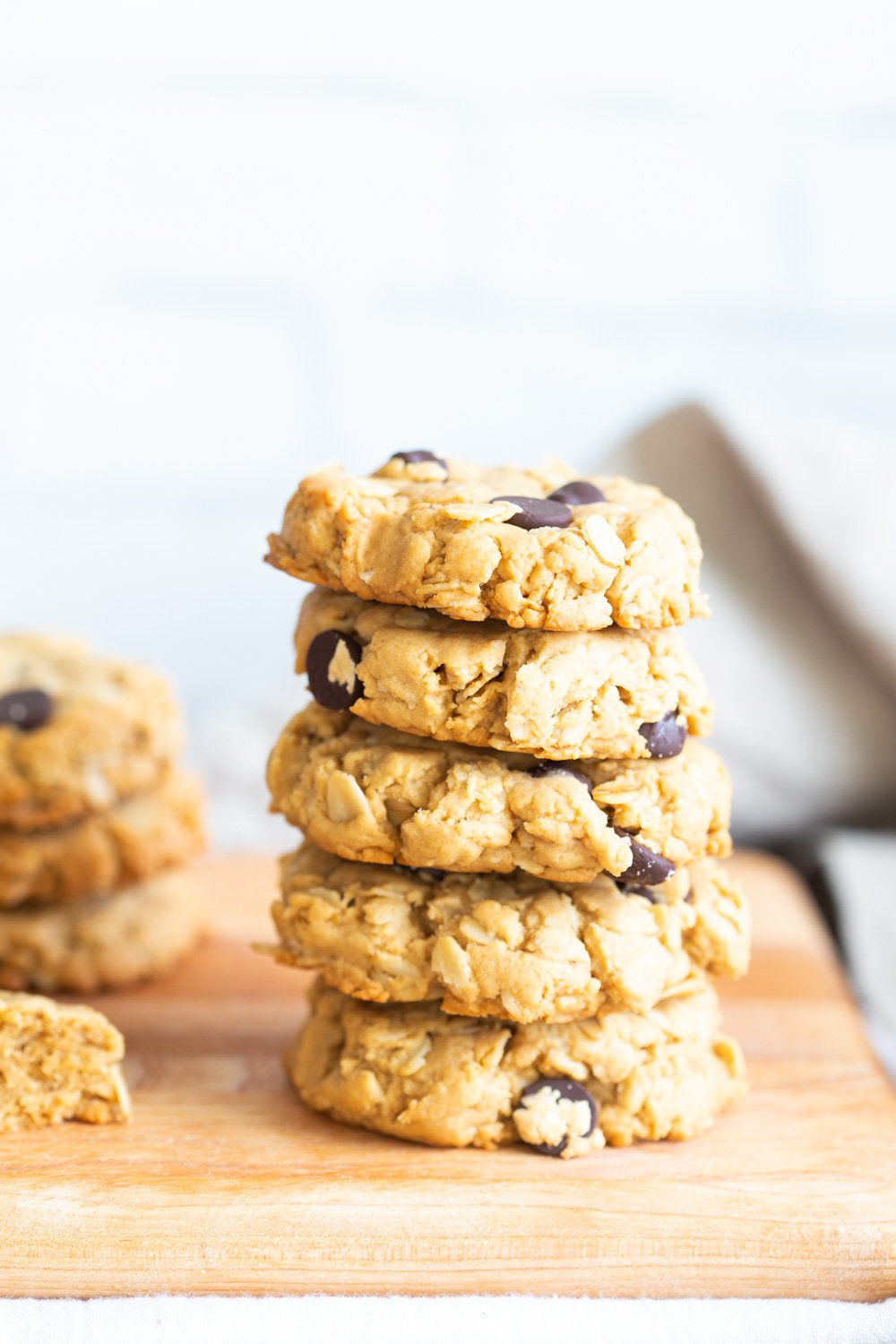 Vegan Peanut Butter Oatmeal Chocolate Chip Cookies on wood board