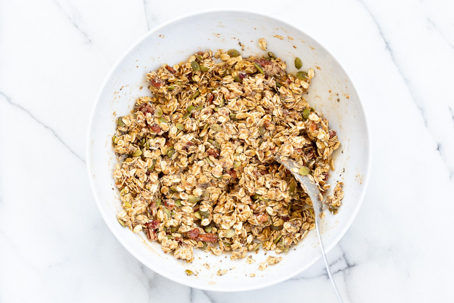 This Date Caramel Maple Pecan Granola is lightly sweet and perfect for any time. Pecans, Oats, coconut, pumpkin and chia seeds and dried blueberries tossed in date caramel and baked to perfection. #Vegan #Granola #Glutenfree #Soyfree #Recipe #VeganRicha Can be nutfree.