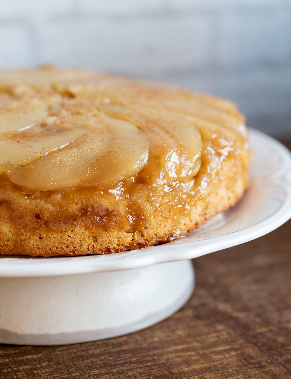 Pear Upside Down Cake on a cake stand