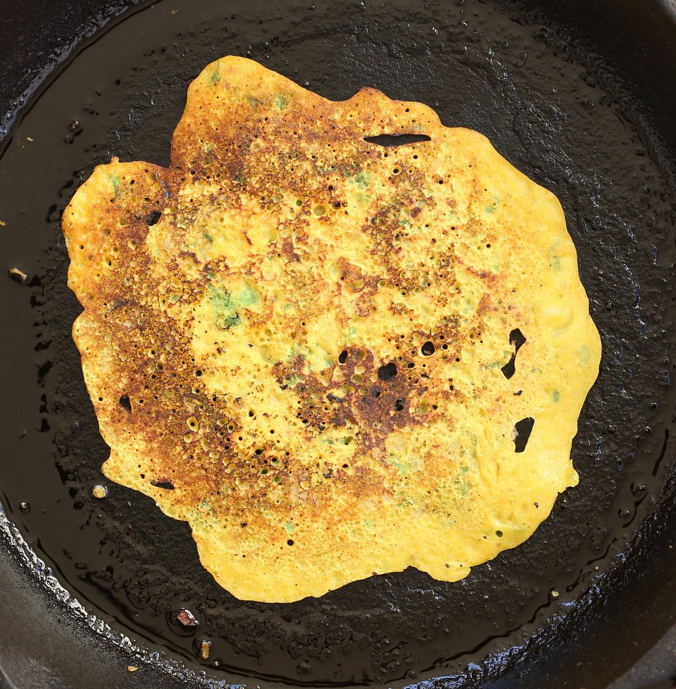 Vegan Chickpea Pancakes on a cast iron skillet