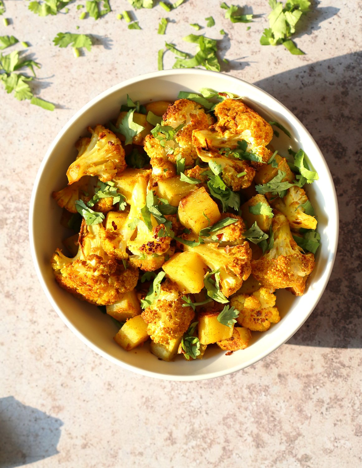 Baked Aloo Gobi - Indian Spiced Potato Cauliflower. 10 Mins Active. Toss with spices, put it to bake, and done! No Standing around, no Mushy Cauliflower! Same Amazing Indian flavor and excellent texture. Tips and options for Aloo Gobi Subzi that bakes perfectly every time! #Vegan #Glutenfree #Soyfree #Nutfree #VeganRicha #aloogobi #Recipe