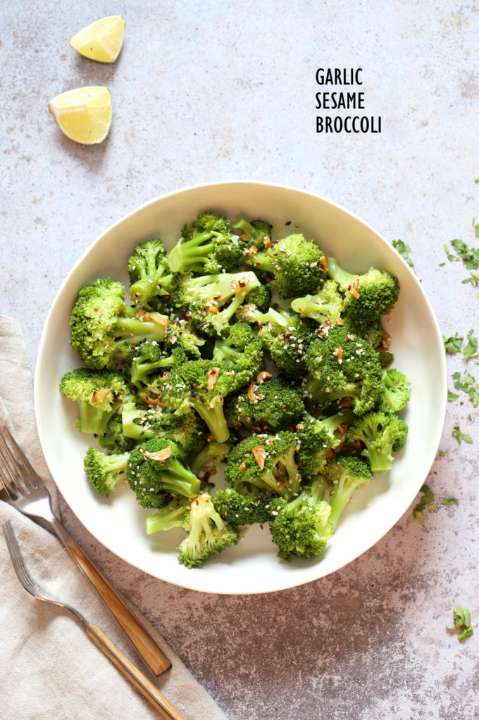 Sesame Garlic Broccoli needs just 6 ingredients. It is vibrant with blanched broccoli and delicious with a simple dressing of garlic roasted with sesame oil. A perfect side. #Vegan #glutenfree #soyfree #nutfree #veganricha #recipe