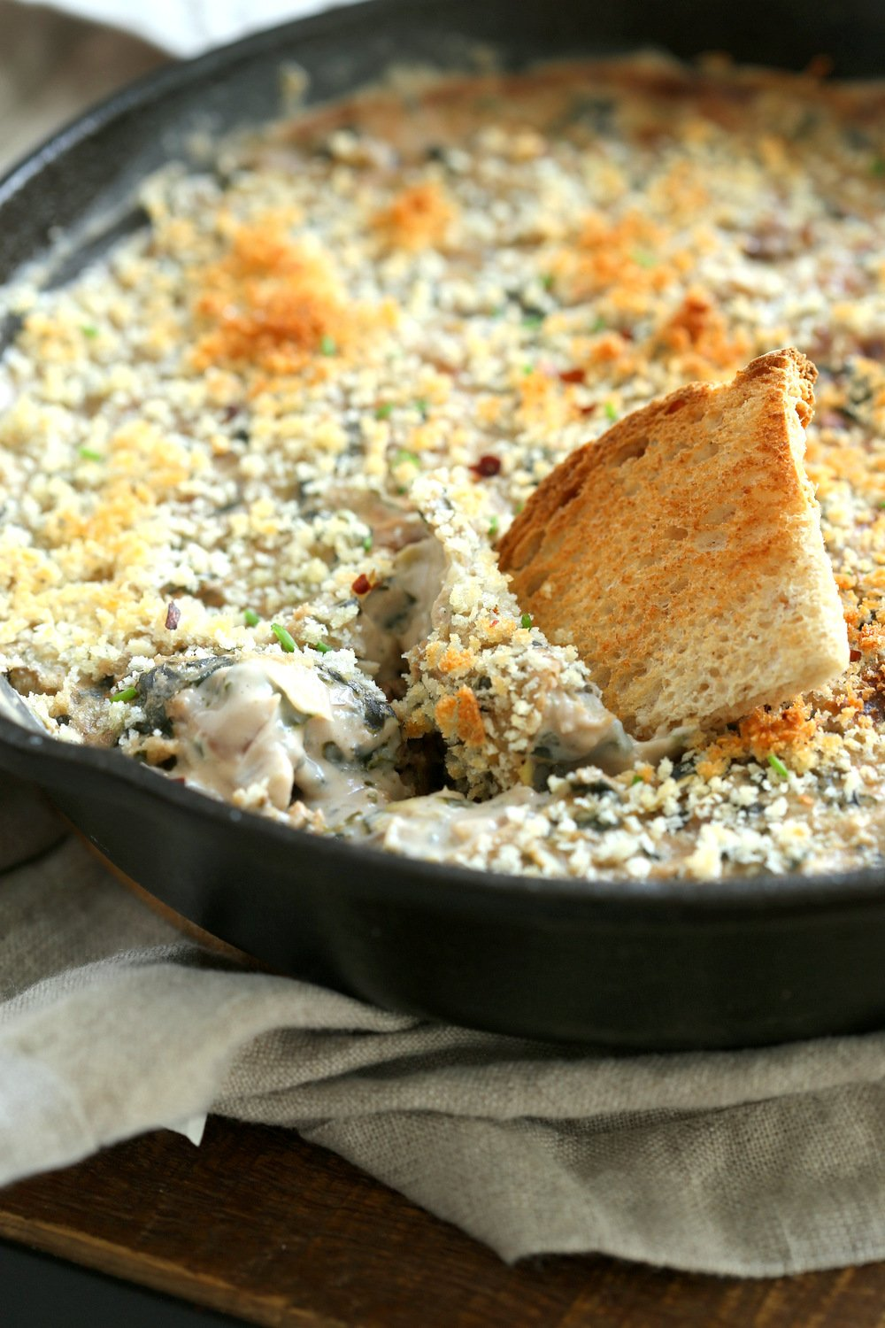 Vegan Spinach Artichoke Dip in a cast iron skillet