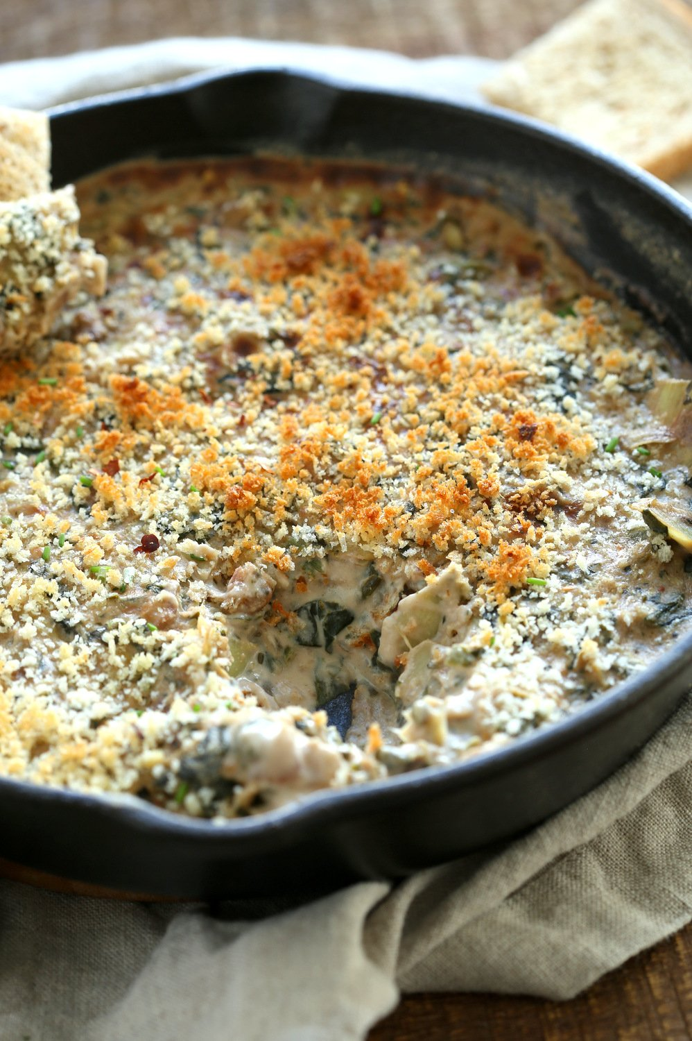 our Vegan Spinach Artichoke Dip in a cast iron skillet