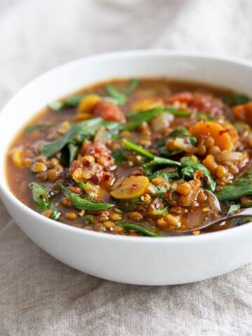 1 PotVegan Lentil Soup made in Instant Pot or Saucepan. This Easy Lentil Vegetable Soup is warming, comforting and so filling. Freezer friendly, #Glutenfree, #Soyfree, #Nutfree #Recipe #vegan #lentilsoup #veganricha  VeganRicha.com
