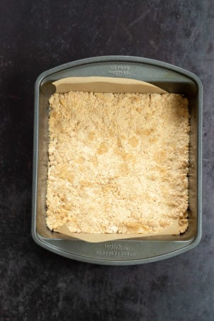 Crust for our Vegan Apple Custard Squares in a lined brownie pan
